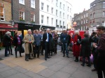 Artemis addressing the tour group outside 28 Shepherd Market