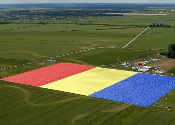 Villagers in Clinceni, Romania cover a field with what they claim is the world's biggest ever flag