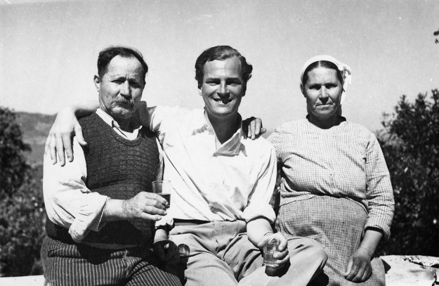 Patrick Leigh Fermor with Spiro and Maria Lazaros, owners of the watermill at Lemonodassos, Greece, where he first stayed in the summer of 1935 (Patrick Leigh Fermor Archive/Trustees of the National Library of Scotland)